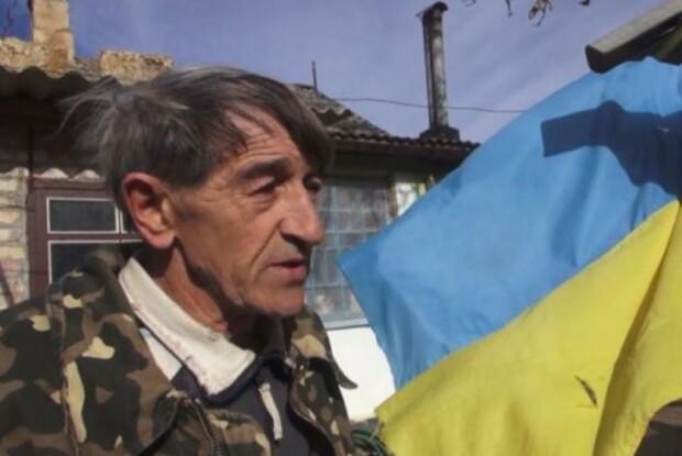 Окупанти покарали кримчанина за український прапор