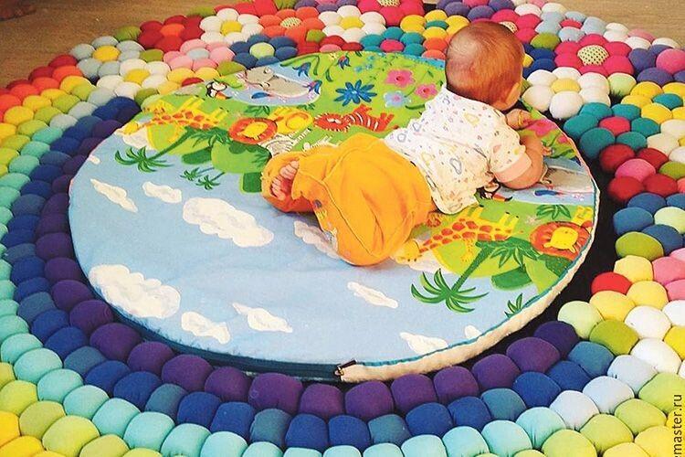 Веселий килимок для малюка