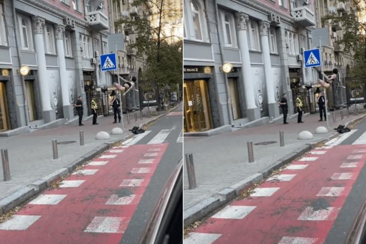 Дівчина влаштувала стриптиз на стовпі дорожнього знаку (Відео)