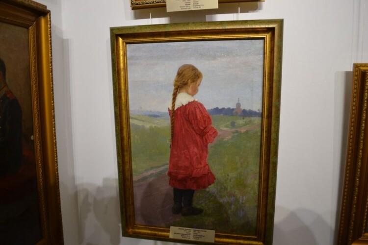 Дівчинка в червоній сукні. Початок ХХ століття.