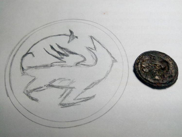 Промальовка зображення симаргла на щитку.